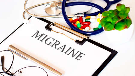 MIGRAINE text with Background of Medicaments, Stethoscope