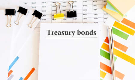 Paper with Treasury bonds on a table. Business