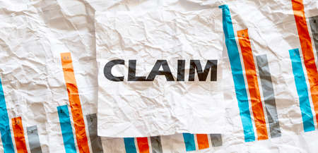 CLAIM word text on white memo note crupled sticker on chart background