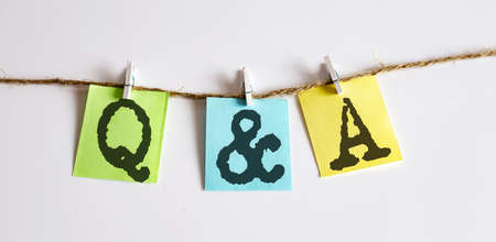 Q and A concept - colorful sticky notes with word seo on the white background
