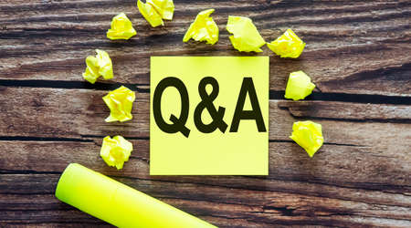 Q and A. Notes about Q and A, concept on yellow stickers on wooden background