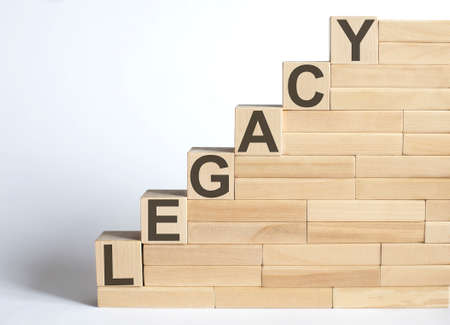 Work strategy on the wood blocks LEGACY on white background Фото со стока