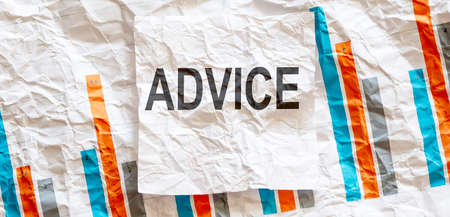 ADVICE word text on white memo note crupled sticker on chart background