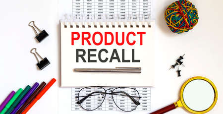 Notebook with Tools and Notes about product recall, business concept 版權商用圖片