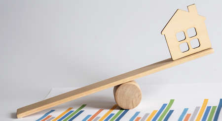 Housing market concept image with graph on the chart background, BALANCE Stock Photo