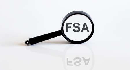 Magnifier with text FSA on white background Stok Fotoğraf