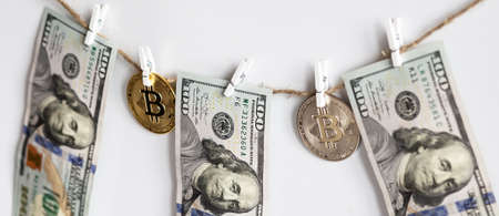 Money laundering of one US Dollar bill with bitcoin for AML Anti laundering finance business crime ideas