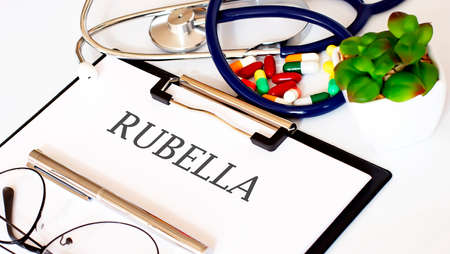 RUBELLA text with Background of Medicaments, Stethoscope