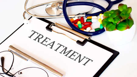 TREATMENT text with Background of Medicaments, Stethoscope