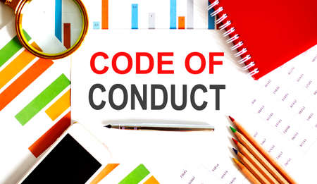 blank note pad with Code of Conduct text on the chart background