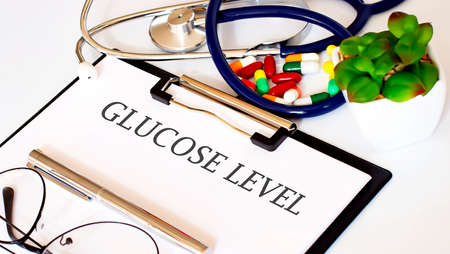 GLUCOSE LEVEL text with Background of Medicaments, Stethoscope
