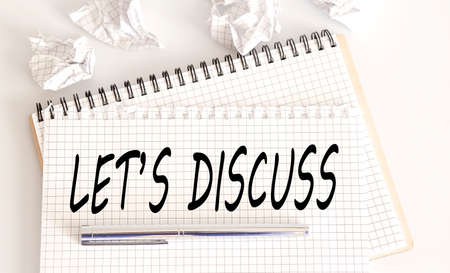text LET'S DISCUSS on notepad on white background. meeting remind reminder note concept,