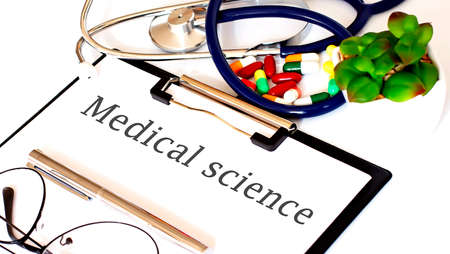 MEDICAL SCIENCE text with Background of Medicaments, Stethoscope Standard-Bild