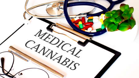 MEDICAL CANNABIS text with Background of Medicaments, Stethoscope