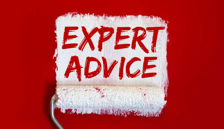 EXPERT ADVICE .One open can of paint with white brush on red background.
