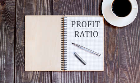 Word Writing Text PROFIT RATIO with pen and cofee. business concept on the wooden background Stock Photo