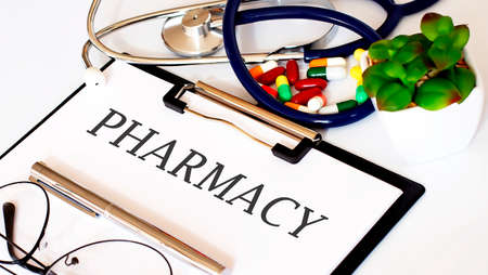 PHARMACY text with Background of Medicaments, Stethoscope