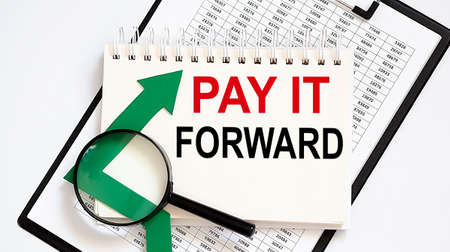 Notebook with Tools and Notes about PAY IT FORWARD with chart