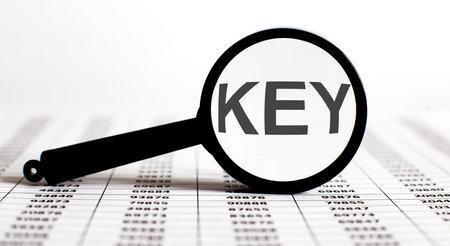Magnifier with text KEY on chart background Reklamní fotografie