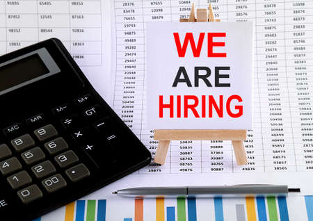 We are Hiring on small easel with charts, pen and calculator.Business