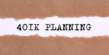 The text 401K Planning in appearing behind torn brown paper, business concept