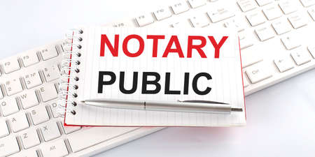 text NOTARY PUBLIC on keyboard on white background