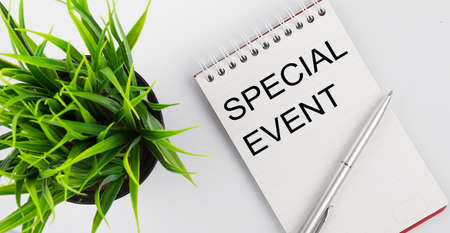 Keyword Special Event - business concept text on white notebook and pen, green flowers