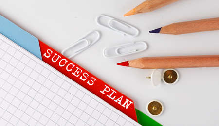 SUCCESS PLAN text on folder register with office tools Banque d'images