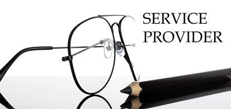 SERVICE PROVIDER text. Glasses and pencil isolated on the white background Stock fotó