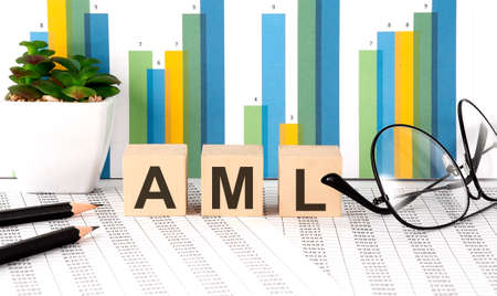 AML word written on wood block with chart, glasses and pencils Stock Photo