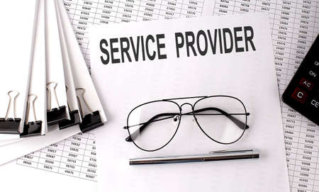 SERVICE PROVIDER text on paper with chart and office tools, business