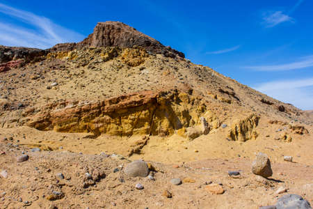 sinai desert: Egyptian yellow mountains and deep blue cloudy sky.