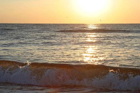 Tropical sunset and ocean waves. Crimea, Ukraine