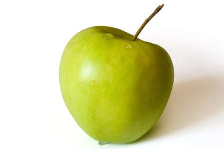 Ripe green apple, with some water drops. Isolated.
