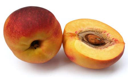 Fresh peach fruit and half, on white background Stock Photo