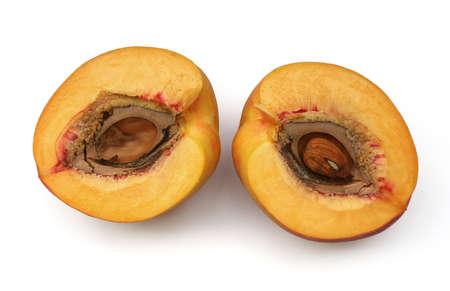 Fresh peach fruit, two halves, on white background Stock Photo