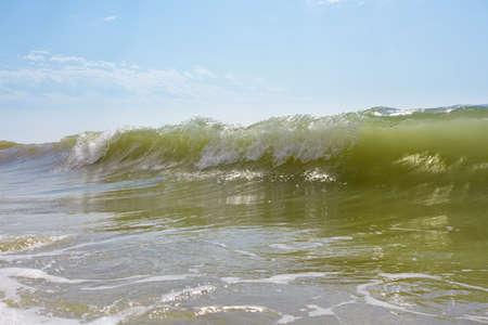 Big emerald wave and blue sky. Black sea, Ukraine