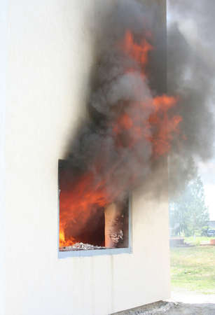Photo of huge flame distracting house on fire. Fire safety concept Stock Photo