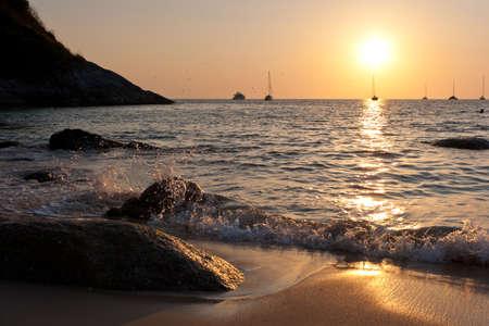 Sunset in Nai Harn cove and sailboats silhouettes. Phuket, Thailand