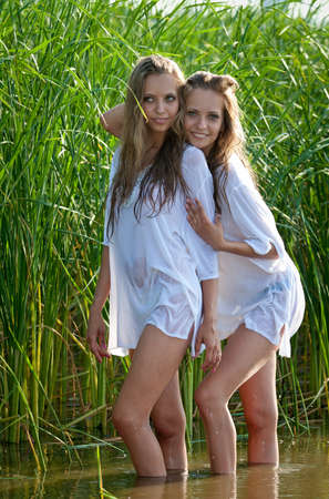 Happy young twin women posing Stock Photo