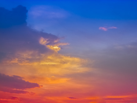 colorful lights: Colorful Sunset with multiple colors of sunlight glow over the country side with a silhouette of coconut trees at the horizon. Stock Photo