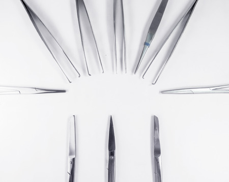 exactness: surgical Scissors arranged in a pattern like in the tray of operation theatertable set. Stock Photo