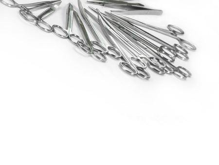 suture: surgical Scissors arranged in a pattern like in the tray of operation theatertable set. Stock Photo
