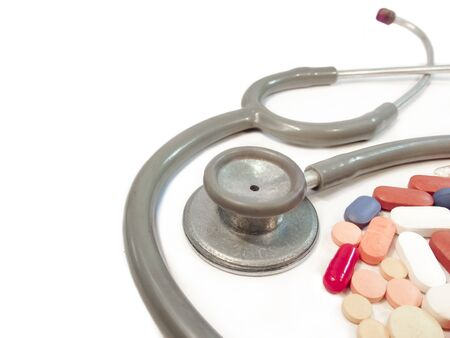 good health: The ingredients of  good health,cure,fast and easy recovery from sickness-stethoscope denotes doctors advice,and medicines as required. Stock Photo