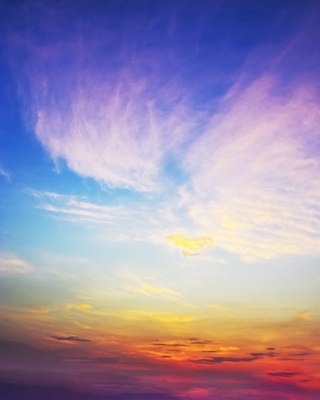 Sunset sky of multiple colors over scaterred rays of lights.South INdia. Stock Photo