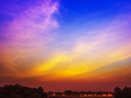 purple sunset: Sunset in a South Indian Tower with evening street lights on foreground -a silhouette Stock Photo