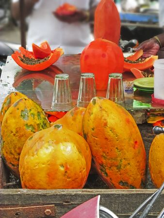 south india: Papaya selling on wheel at roadside mobile in South India,South Asia Stock Photo