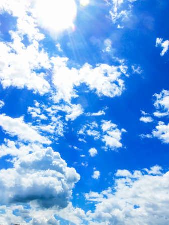 cloud shape: Sunny day clouds with Sunray scatterd on them. Stock Photo