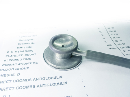 exactness: stethoscope on Medical report  isolated on white. Stock Photo