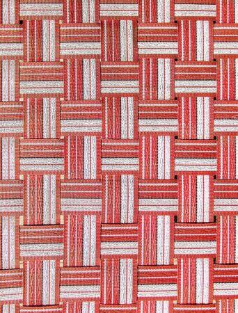 crisscross: Red,white and black plastic woven crisscross texture.
